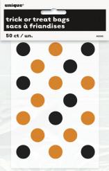 Snoepzak doorschijnend met oranje en zwarte stippen.